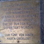 Sign in Sidewalk in Herminengasse, Vienna, in memory of Holocaust victims who once resided there.